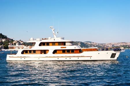 Luxury white yacht sails in Bosporus waters