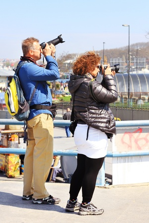 ISTANBUL - APRIL 12: Unidentified travelers take pictures on Galata Bridge of Goldenhorn on April 12, 2012 in Istanbul. The bridge is the major strolling and tourism center in city. Stock Photo - 13574409