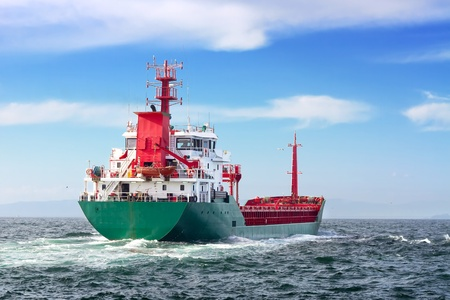 freighter: Tanker ship sailing in to the open sea  Editorial