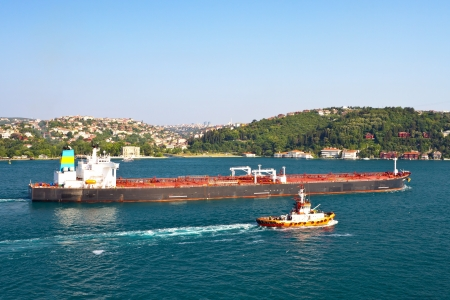 guard ship: Crude oil tanker with a fire boat sailing in straits, Turkey