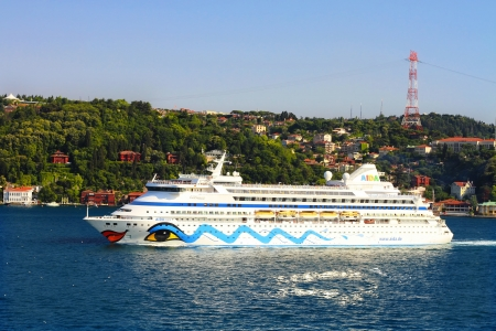ISTANBUL - JULY 5: Passenger Ship AIDA Aura (IMO: 9221566, Italy) on July 5, 2012 in Istanbul. A 203 mt long, 28 mt width vessel, launched into the sea in 2003 and has a capacity of 1,300 passengers. Luxury Passenger Ship