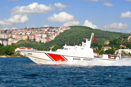 enforce: ISTANBUL - JULY 5: Turkish coast guard boat TCSG-303 on July 5, 2012 in Istanbul. A 25 mt long, 7 mt width law enforce vessel, has a maximum speed of 41 knots. Editorial