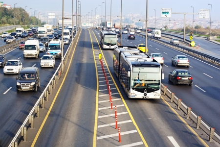 slow lane: ISTANBUL - NOVEMBER 2: Trans-European Motorway on November 2, 2009 in Istanbul. Express Metrobus Line planed as a solution to transport problem in city with a daily capacity of 800,000 passengersday.