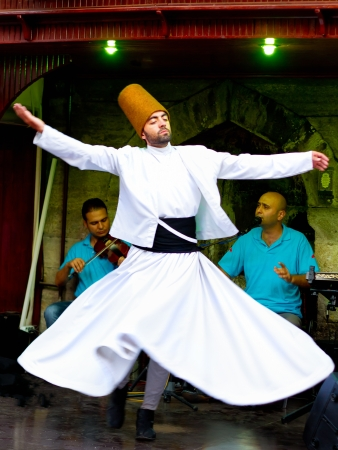 konya: ISTANBUL - JULY 25: Sufi whirling dervish (Semazen) dances at Sultanahmet during holy month of Ramadan on July 25, 2012 in Istanbul. Semazen conveys God