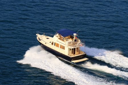 speed boat: Aerial view of a yacht with splash and wake Stock Photo