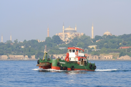 ISTANBUL - JUNE 11: Water surface cleaning boat sailing in to Bosporus on June 11, 2012 in Istanbul. Debris and bilge water collected by Istanbul municipality workers reaches about 30.000 tons/year. Supurge-3 Stock Photo - 15394972
