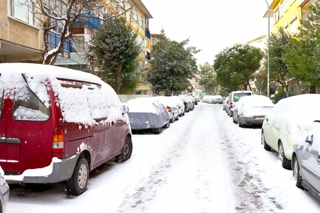 Winter day with parked cars trapped under snow in Istanbul