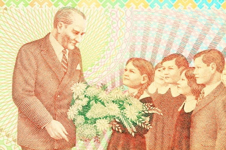 Close up of old Turkish banknote (100,000 TL). Ataturk with child symbolizes the revolution of new Turkish alphabet