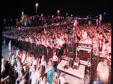 onstage: ISTANBUL - JUL 7: Singer Bulent Ersoy performs onstage at the annual Summer Concert events on the Maltepe open-air stage on July 7, 2012 in Istanbul. Led panel shows large crowd watching the concert