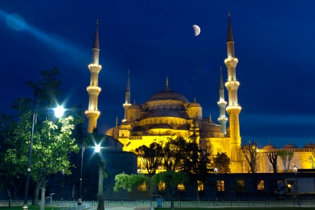 Blue Mosque at night  Sultanahmet Cami in Istanbul with shining half moon  photo