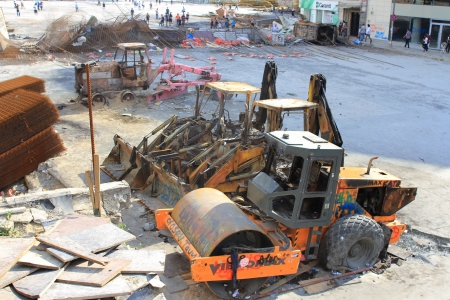 reconstructed: ISTANBUL - JUN 13: Protests turn to violent as police crack down on June 13, 2013 in Istanbul, Turkey. Construction machines had been parked on the part of Taksim Square being reconstructed.