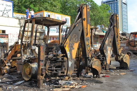 reconstructed: ISTANBUL - JUN 13: Protests turn to violent as police crack down on June 13, 2013 in Istanbul, Turkey. Construction machines had been parked on the part of Taksim Square being reconstructed; their fate was rather inevitable. Editorial