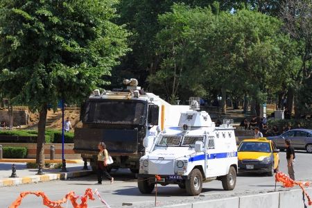 dissident: ISTANBUL - JUN 17: The police wait in their vehicles in front of Gezipark on June 17, 2013 in Istanbul, Turkey. Riot police dispersed protesters from the park using tear gas and water on early Sunday.