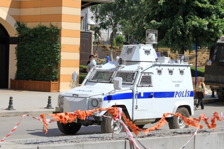 insurrection: ISTANBUL - JUN 17: The police wait in their vehicles in front of Gezipark on June 17, 2013 in Istanbul, Turkey. Riot police dispersed protesters from the park using tear gas and water on early Sunday.
