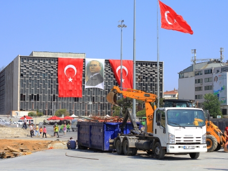insurrection: ISTANBUL - JUN 17: A bulldozer clears construction materials used by protesters to make barricades in Taksim Square on June 17, 2013 in Istanbul. Demonstrations escalated into anti-government protest.