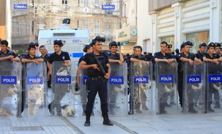 nationwide: ISTANBUL - JUN 17: Five labor unions call 1-day nationwide strike over crackdown on June 17, 2013 in Istanbul, Turkey.  Police blocked all the ways to prevent the activists march to the Taksim Square Editorial