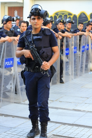 insurrection: ISTANBUL - JUN 17: Labor unions call 1-day nationwide strike over crackdown on June 17, 2013 in Istanbul, Turkey. Police wait in full riot gear on Istiklal Street to prevent people march to the Taksim Square. Editorial