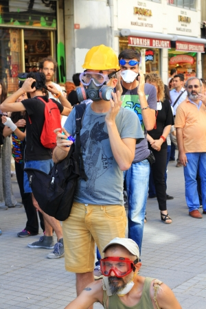 nationwide: ISTANBUL - JUN 17: Five labor unions call 1-day nationwide strike on Monday over crackdown on June 17, 2013 in Istanbul, Turkey. Demonstrators gather during the protest at Istiklal Street