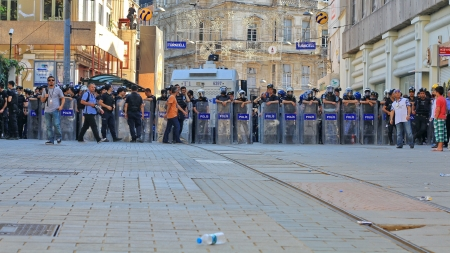 insurrection: ISTANBUL - JUN 17: Five labor unions call 1-day nationwide strike over crackdown on June 17, 2013 in Istanbul, Turkey. Police lined up against demonstrators during the protest on Istiklal Street.