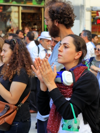 dissident: ISTANBUL - JUN 17: Five labor unions call 1-day nationwide strike over crackdown on June 17, 2013 in Istanbul, Turkey. Labor union members clap as they gather to protest against police brutality