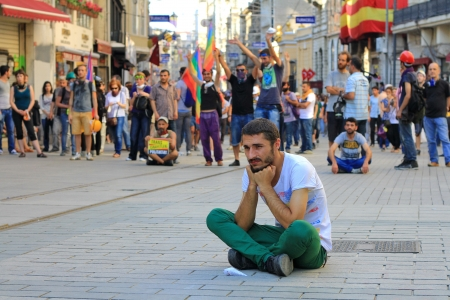 insurrection: ISTANBUL - JUN 17: Labor unions call 1-day nationwide strike over crackdown on June 17, 2013 in Istanbul, Turkey. A protester sits down in front of the riot police as demonstrating police brutality.