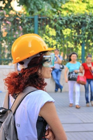 nationwide: ISTANBUL - JUN 17: Five labor unions call 1-day nationwide strike over crackdown on June 17, 2013 in Istanbul, Turkey.  A demonstrator wearing gas-mask and glasses to protect from pepper gas at Istiklal Street