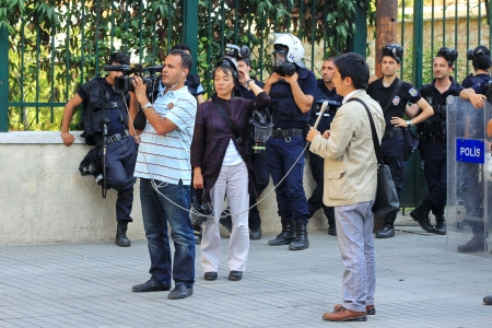 nationwide: ISTANBUL - JUN 17: Five labor unions call 1-day nationwide strike over crackdown on June 17, 2013 in Istanbul, Turkey. International journalists report live in front of police line at Istiklal Street