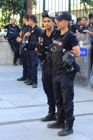 insurrection: ISTANBUL - JUN 17: Five labor unions call 1-day nationwide strike over crackdown on June 17, 2013 in Istanbul, Turkey. Police wearing full equipment belt wait against demonstrators on Istiklal Street Editorial