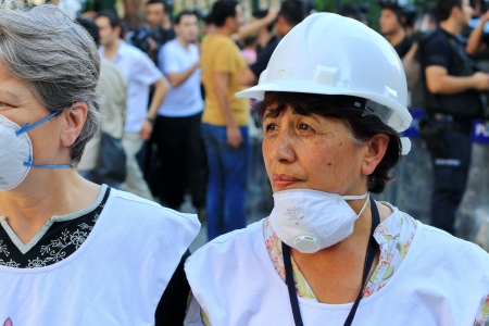 abuses: ISTANBUL - JUN 17: Labor unions call 1-day nationwide strike over crackdown on June 17, 2013 in Istanbul, Turkey. Human rights members wearing white helmet and shirt, monitor possible abuses during demonstration Editorial