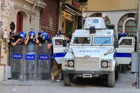 nationwide: ISTANBUL - JUN 17: Five labor unions call 1-day nationwide strike over crackdown on June 17, 2013 in Istanbul, Turkey. Police team with full equipment wait a dead-end street. Editorial