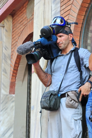 insurrection: ISTANBUL - JUN 17: Five labor unions call 1-day nationwide strike over crackdown on June 17, 2013 in Istanbul, Turkey. A local cameraman recording the demonstration at Istiklal Street