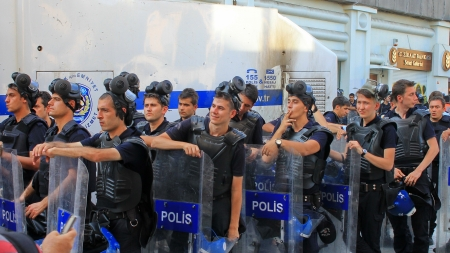 nationwide: ISTANBUL - JUN 17: Five labor unions call 1-day nationwide strike over crackdown on June 17, 2013 in Istanbul, Turkey. Police lined up on Istiklal Street during the protest.