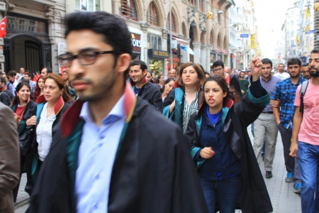 insurrection: ISTANBUL - JUN 12: Turkish lawyers march in support of anti-government protests at Istiklal Street on June 12, 2013 in Istanbul. They were detained yesterday by police while protesting in courthouse.