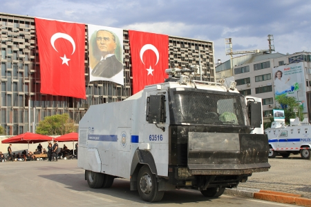 akm: ISTANBUL - JUN 12: Plans to build on Gezipark led to anti government unrest on June 12, 2013 in Istanbul, Turkey. The police wait in their vehicles in front of AKM building whilst the protesters occupy the park.