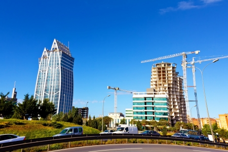 Modern futuristic buildings construction and blue sky photo