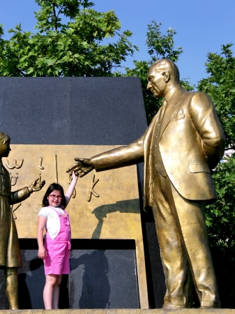 Statue of Ataturk with child symbolizes the revolution of new Turkish alphabet photo