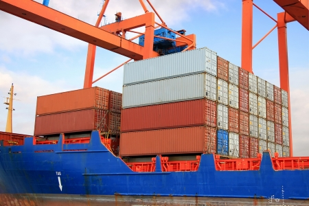 portage: Stacked containers on ship deck