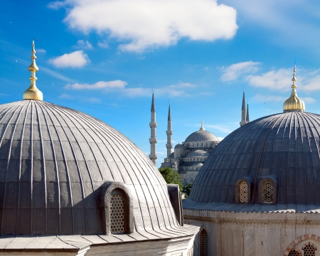 Domes and minarets of Istanbul  In the distance Blue Mosque photo