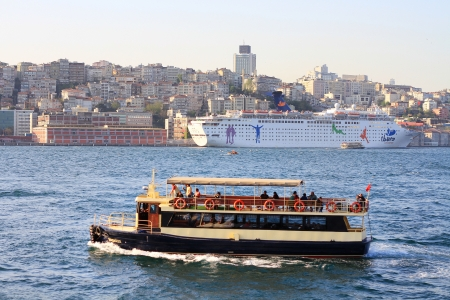 sight seeing: ISTANBUL - APR 29: Pleasure boat sailing into harbor on April 29, 2013 in Istanbul. Sight seeing by boat getting more popular here for tourists. Pleasure boat underway
