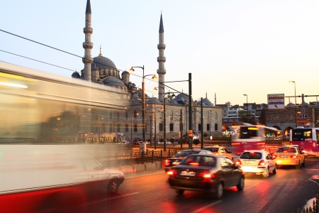 ISTANBUL - OCT 17  Evening traffic at Eminonu on October 17, 2012 in Istanbul, Turkey  Eminonu side is major travel and tourism centre in the city  Eminonu Square with Valide Sultan Mosque