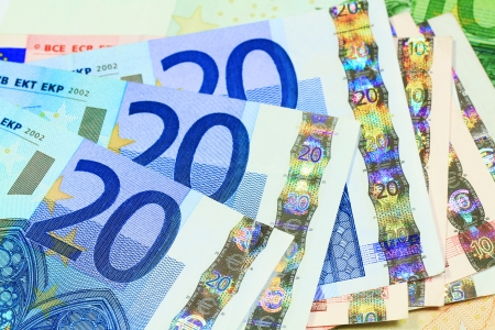 euro banknote: European currency money background  Macro details of 20 Euro notes laid out as fan
