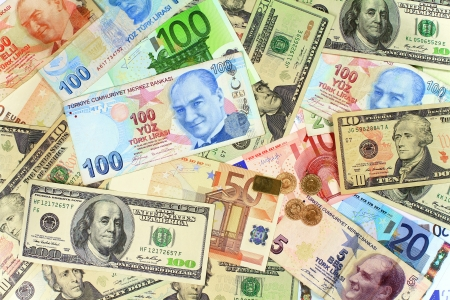 One hundred Turkish Lira banknote on other currencies  Background from dollars and euro bills