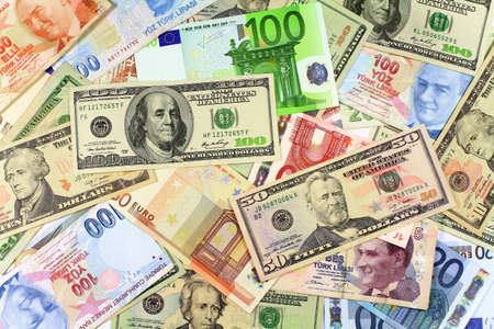 One hundred and fifty dollar banknotes on other currencies  Background from dollars and euro bills