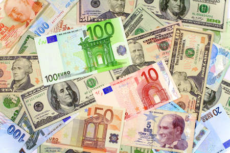 one hundred euro banknote: One hundred Euro banknote on other currencies  Background from dollars and euro bills
