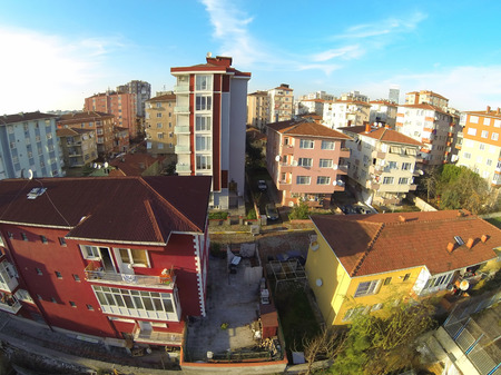 Colorful apartment houses. Residential housing community in Maltepe, Istanbul. Aerial view of suburban neighborhood and residential blocks. Low income family residential development in an urban area in Turkey