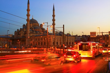 Galata Bridge and Yeni Mosque in Istanbul  Long exposure with traffic movement photo