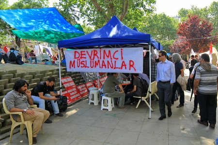 anti capitalist: ISTANBUL - JUN 14  Protesters refuse to leave Gezipark despite assurances on June 14, 2013 in Istanbul, Turkey  Demonstrators defying an order to end almost two weeks of protest against Prime Minister
