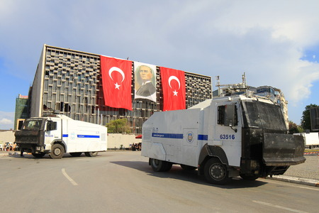 ISTANBUL - JUN 14  The police wait in their vehicles in front of AKM building on June 14, 2013 in Istanbul, Turkey  Riot police dispersed protests from Taksim Square using tear gas and water