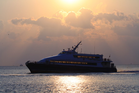seabus: City sea bus cruising against sunset.  A view from Marmara Sea with a domestic sea bus. Editorial
