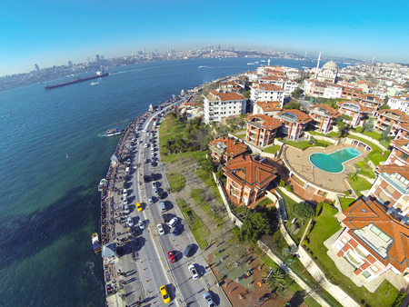 Luxury water front properties at Uskudar, Istanbul. Aerial view of many houses and busy street. Looking down on a residential housing community in front of Maidens Tower